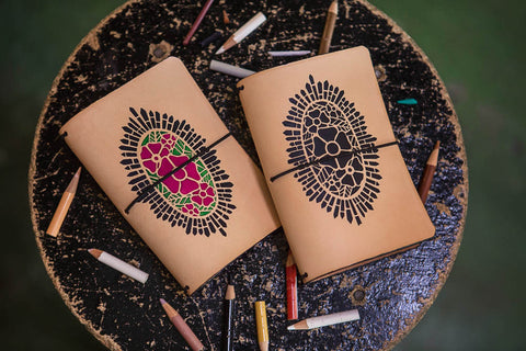 Cathedral Rose travelers notebooks on a small table.