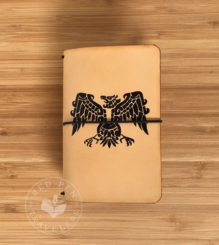 Undyed travelers notebook with Aztec eagle on cover.