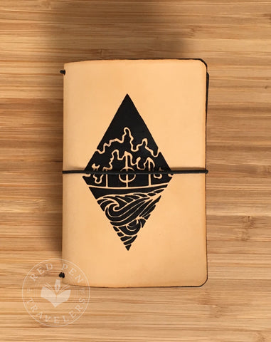 Undyed travelers notebook with Hidden Village design on the cover.