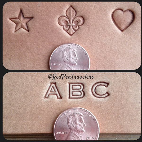 Size example of custom stamps next to pennies: star, fleur de lis, heart, A, B, C.