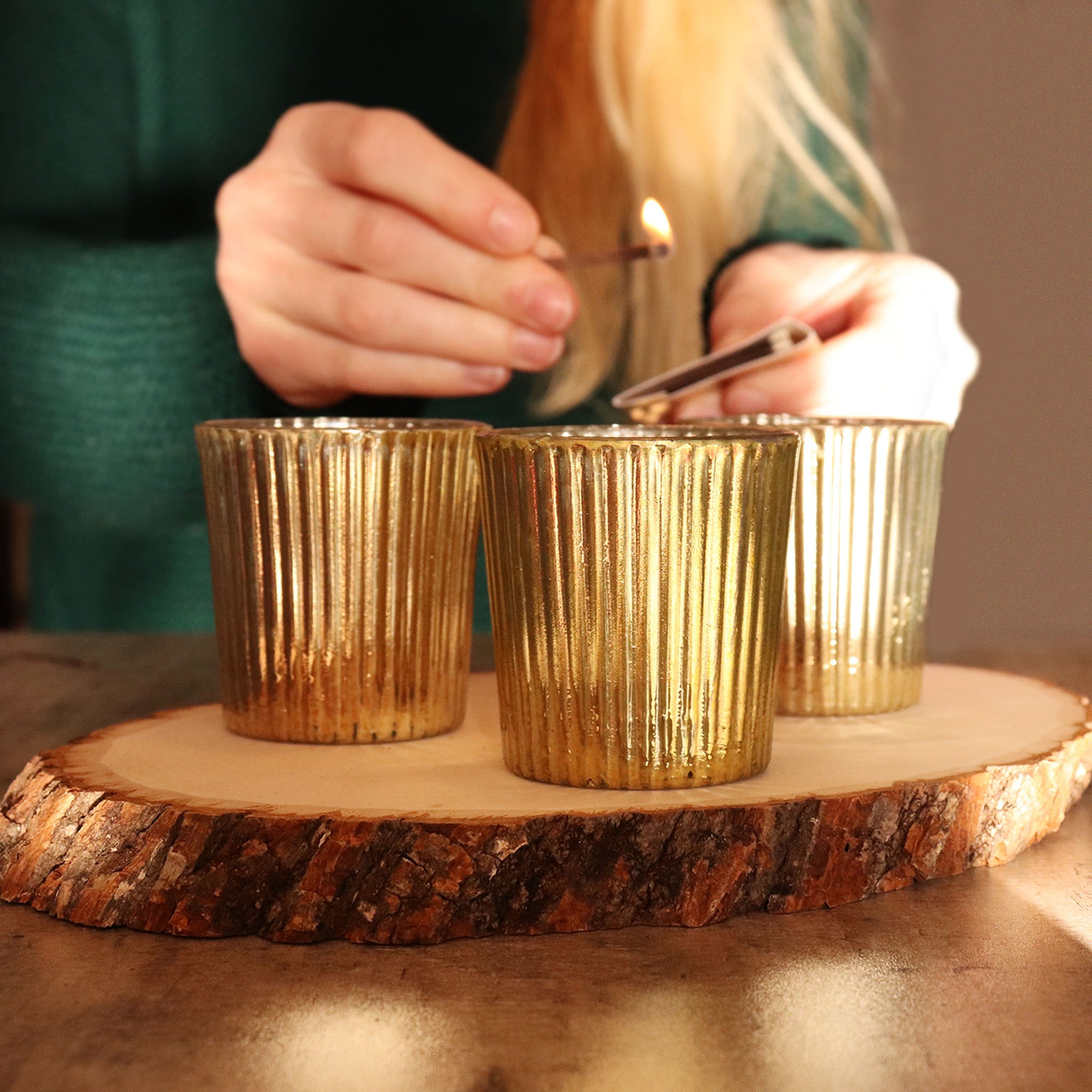 Gold metallic tea light candle holders create the perfect warm ambience. Small candle holders for weddings.