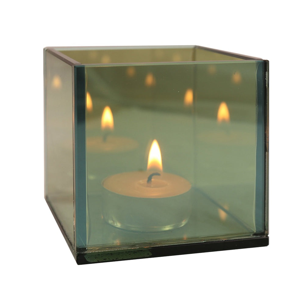 This small mirrored cube tea light candle holder will create an endless light effect. - Candlestock.com
