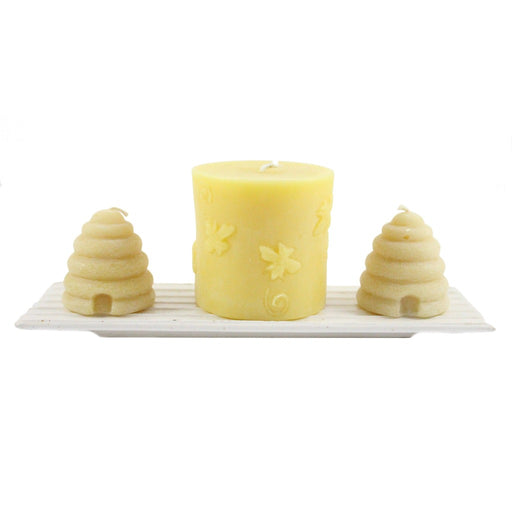 Enjoy this novelty handmade beeswax pillar candle decorated with adorable bees. - candlestock.com
