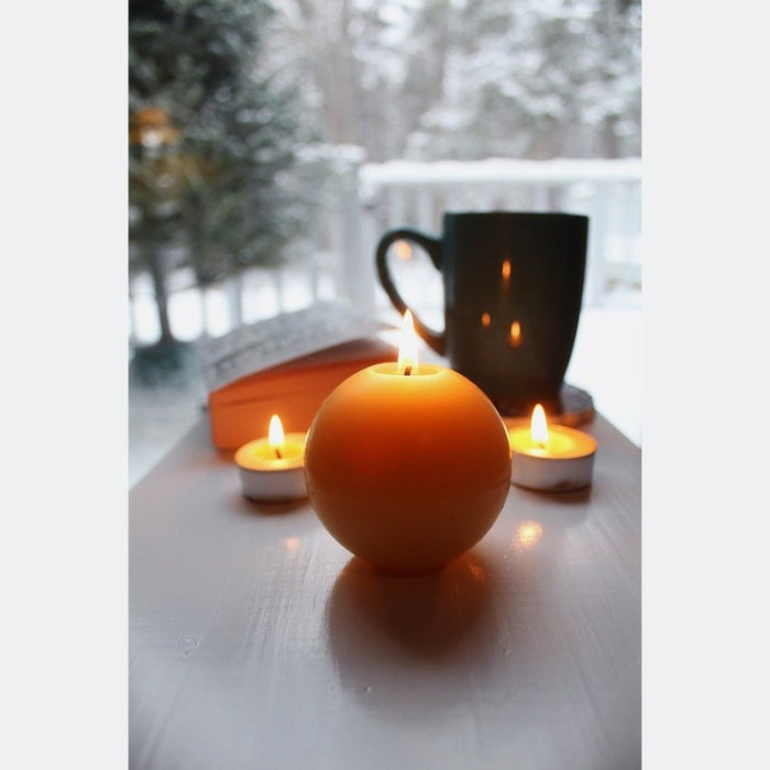 Brighten your home decor with the light from our handmade all natural pure beeswax ball candle. - candlestock.com