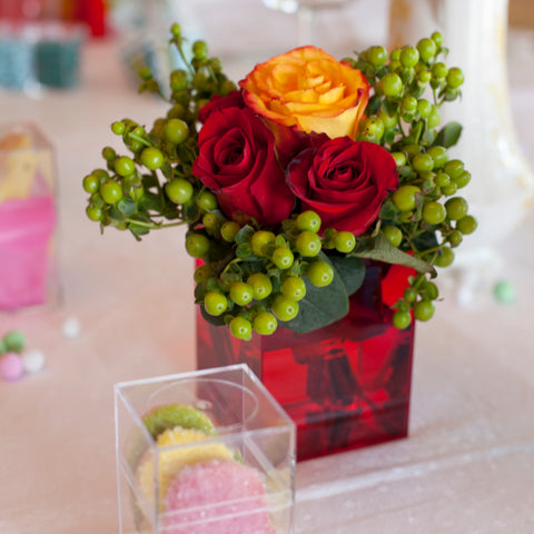 Ember 105C box with yellow roses flower arrangement on a tabletop