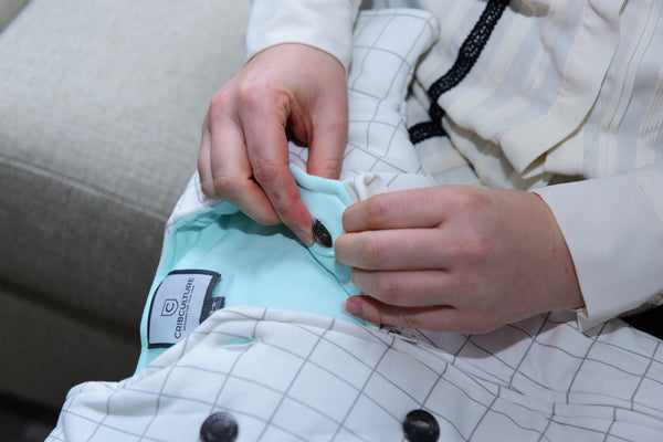Grid with Mint CribCulture SleepSuit® with SleepCool System™