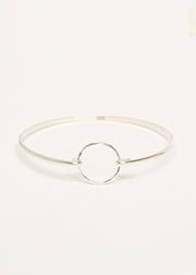 A simple 925 Sterling Silver Bangle with a Circle Clasp on a Grey Background