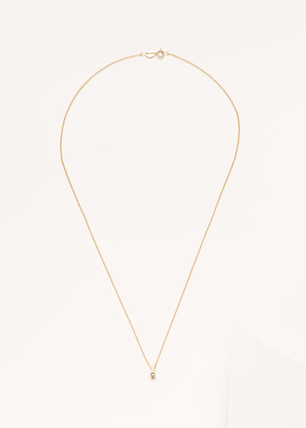 A diamond necklace with 9ct yellow gold on a grey background