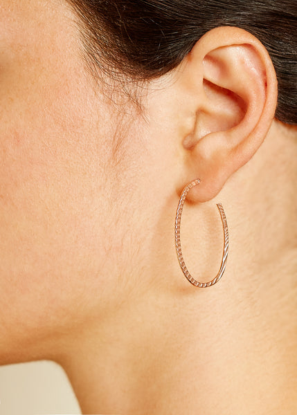 A model wearing a Rose Gold Plated 925 Sterling Silver Hoop Earring with Texture