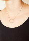 A model wearing a Rose Gold Plated 925 Sterling Silver Necklace with Textured Oval Charm