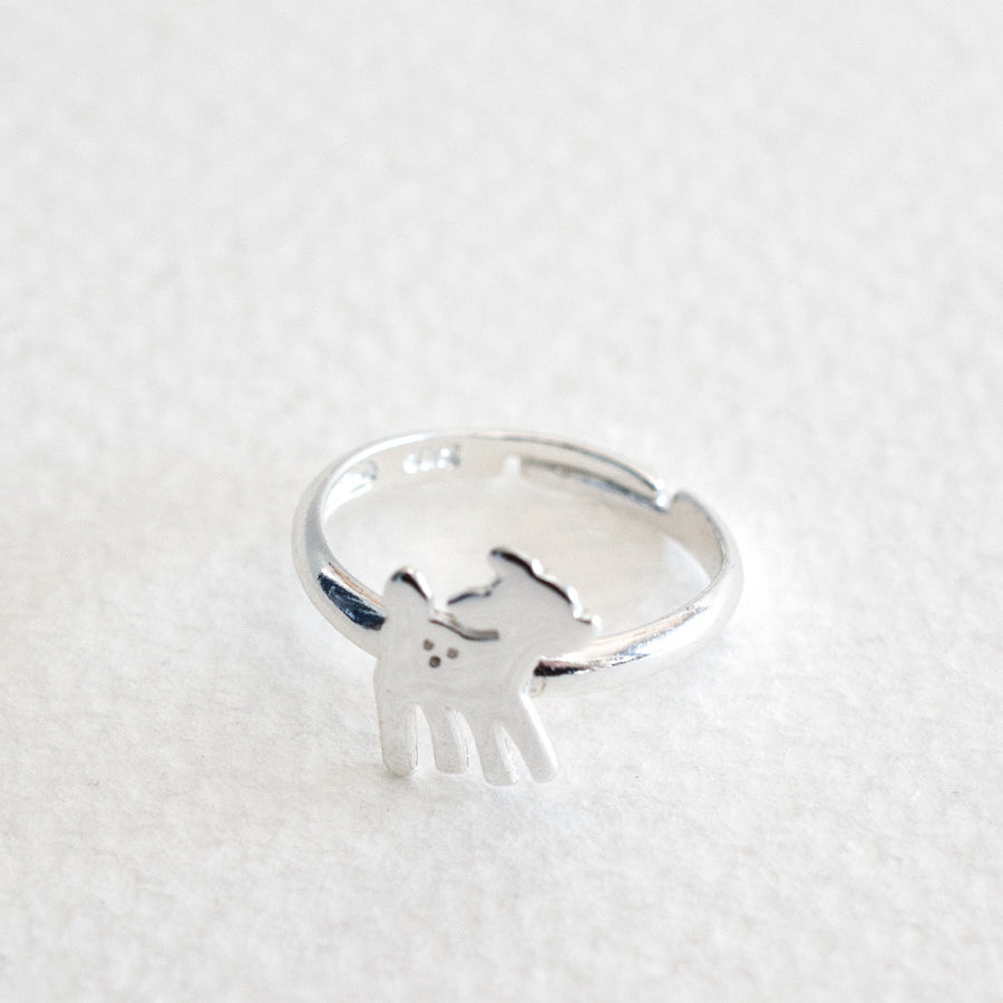 A 925 sterling silver deer or bambi shaped ring with adjustable childrens sizing, on a grey background