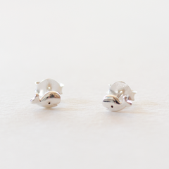 A pair of sterling silver whale shaped stud earrings