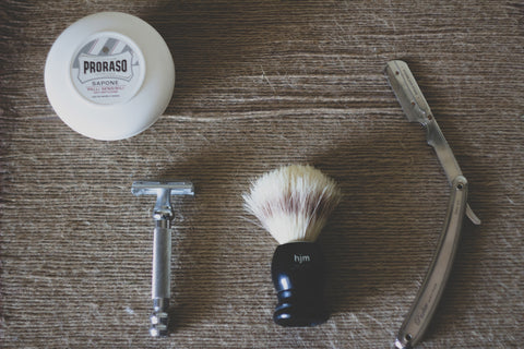 Men grooming kit on a wood table | Parlour.Club