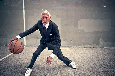 Old stylish men in suit playing basketball