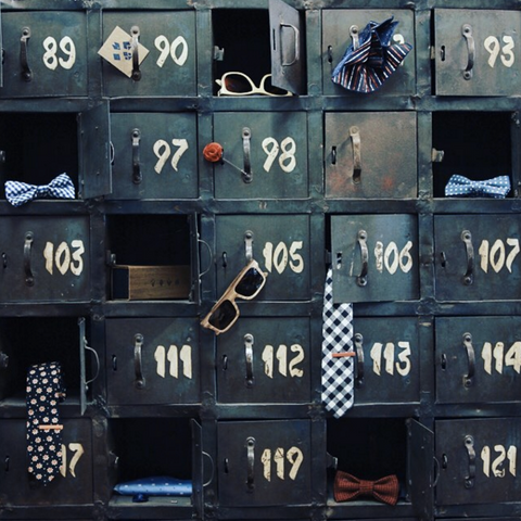 Picture of old lockers filled with men's accessories