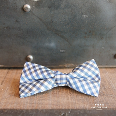 Bow tie white and light blue checker pattern on wood shelf- Parlour.Club