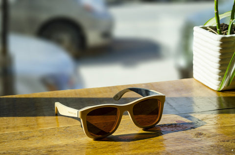 Wood Sunglasses on wooden table | Parlour.Club
