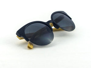 Romy Wave Bamboo Sunglasses folded | Parlour.Club
