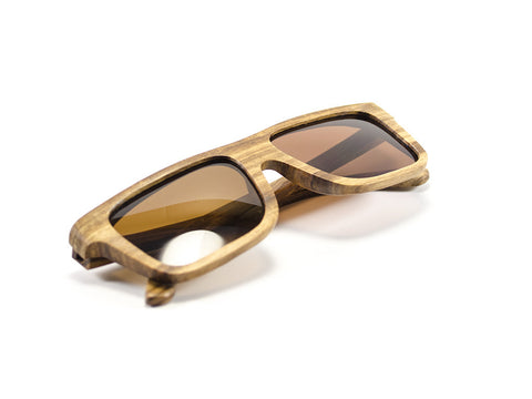 Zebra Wood Sunglasses folded view - Model Ajax - Parlour Club