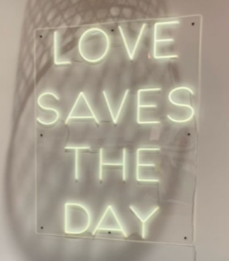 love saves the day neon sign