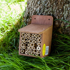 bee home with packed bamboos
