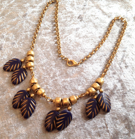 Vintage early plastic hand painted blue and gold leaves dangles necklace
