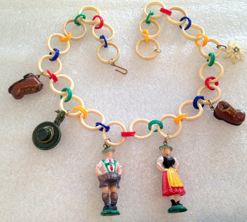 Vintage Tyrol's figurines, hat, shoes celluloid necklace - Talma's Work&Shop  - 1