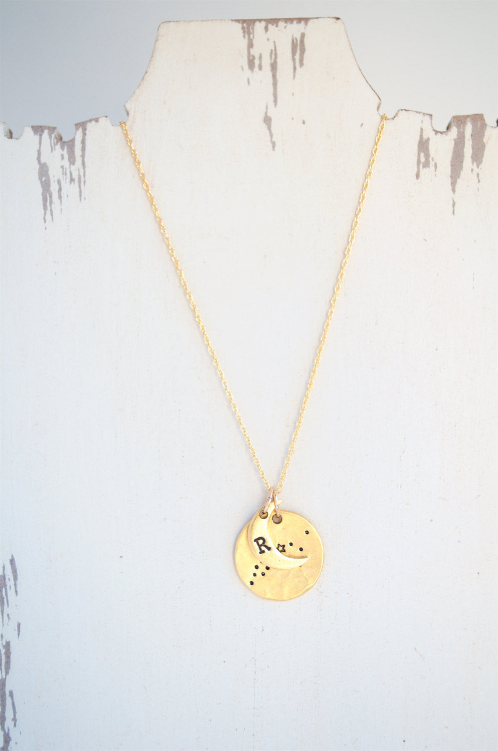 One zodiac constellation necklace on a display.