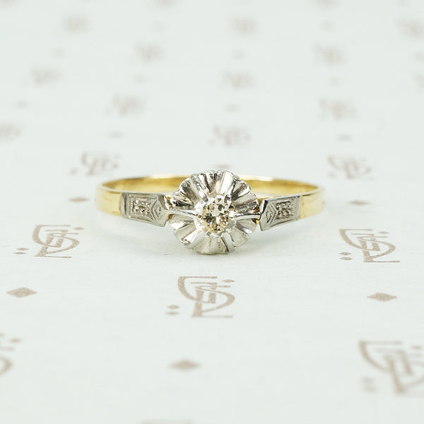 platinum and 18k yellow gold engagement ring with fluted head