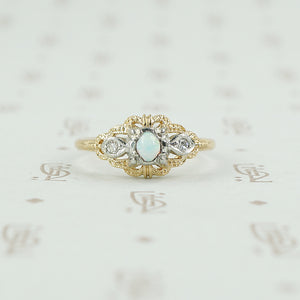 2 tone gold opal and diamond ring