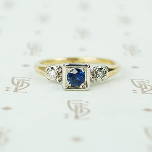 2 tone white and yellow gold 1940's engagement ring with sapphire and side diamonds