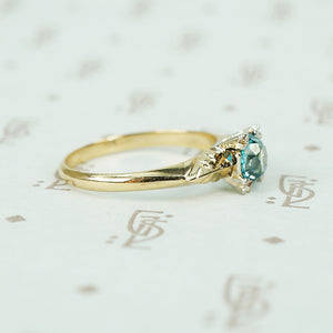1/2 carat natural blue zircon in 2 tone 14k gold setting vintage engagement ring side view