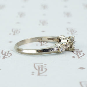 1940's white gold bow tie diamond engagement ring side view