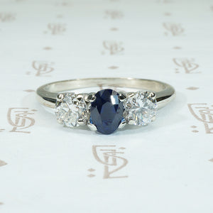 18k white gold sapphire and diamond 3 stone ring