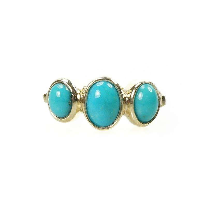 A 3 Stone Turquoise Ring set in 14k yellow gold by 720 Gem Set Love