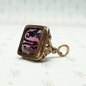 Fancy Amethyst-Colored Glass Fob