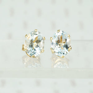 oval aquamarines in 14k gold studs