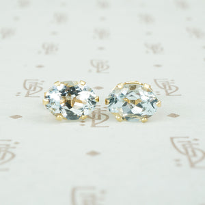 Oval Aquamarine Studs in Yellow Gold
