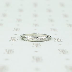 channel set diamond white gold band with arrow design