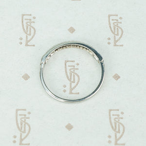 channel set diamond white gold band with arrow design side view