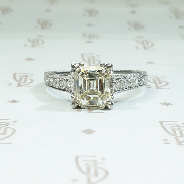 1.46 carat emerald step cut antique diamond engagement ring in platinum