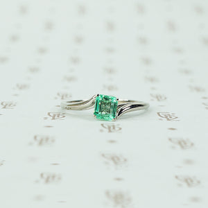 mid century platinum and emerald engagement ring