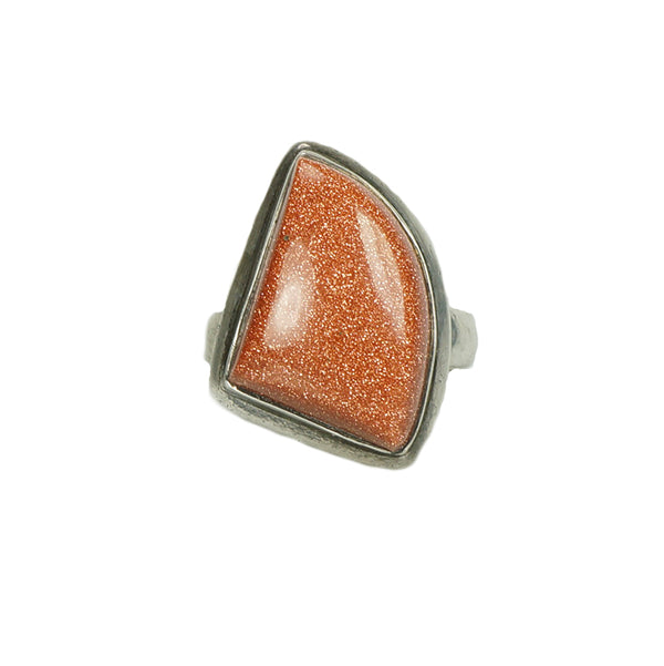 asymmetrical sterling silver ring with a sparkling piece of goldstone