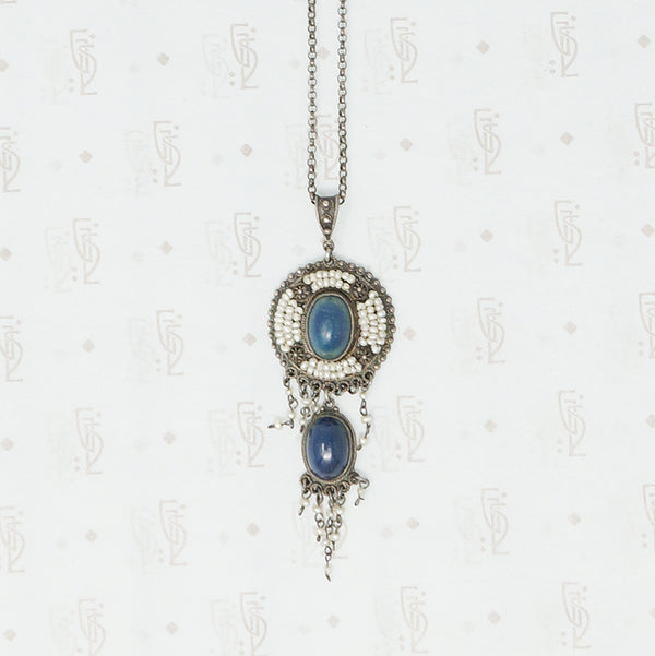 detail view of austro-hungarian lapis and seed pearl pendant in silver