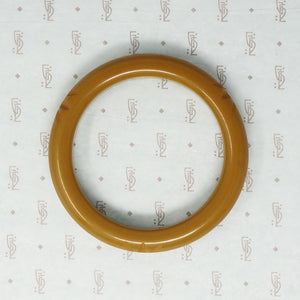 Bakelite Bangle with Stylized Hawaiian Blossom