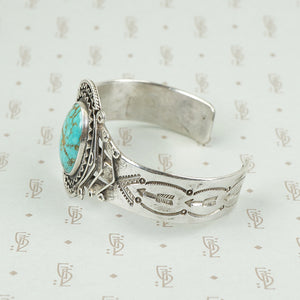side view american silver cuff with arrow pattern and big turquoise