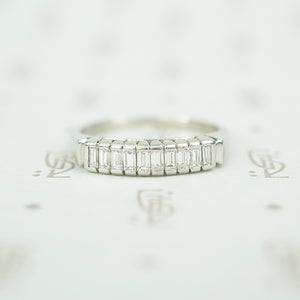 10 straight baguettes set vertically in platinum mid 20th century diamond band