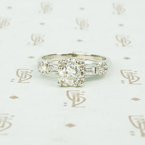 1940's platinum .80 oec diamond ring with diamond baguette sides