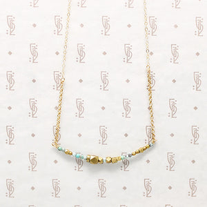 Turquoise & Brass Bead Arc Necklace by Brin