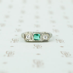 belias white gold filigree 3 stone ring emerald and diamond